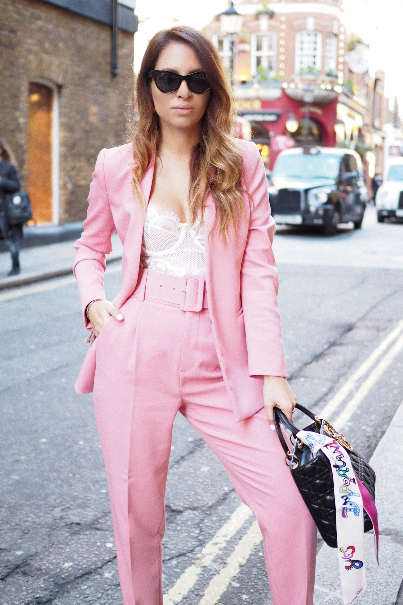 Pink suit and white lace bodysuit at London Fashion Week